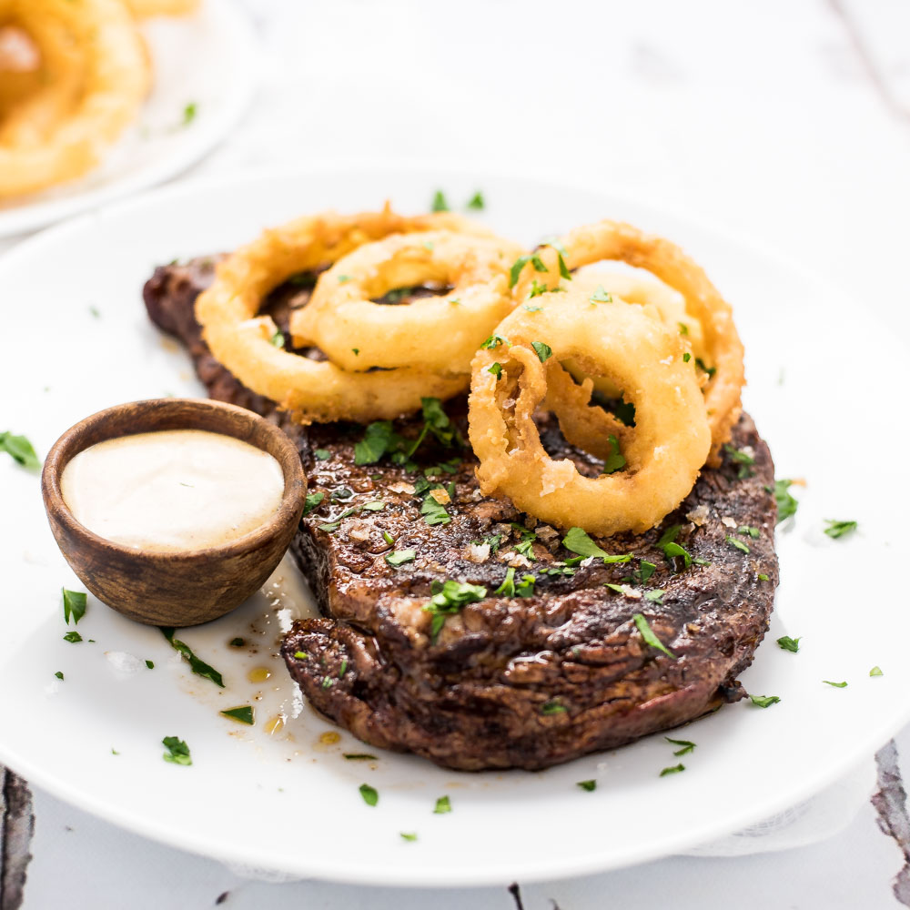 Chili-Rubbed Ribeye Steak with Beer-Battered Onion Rings